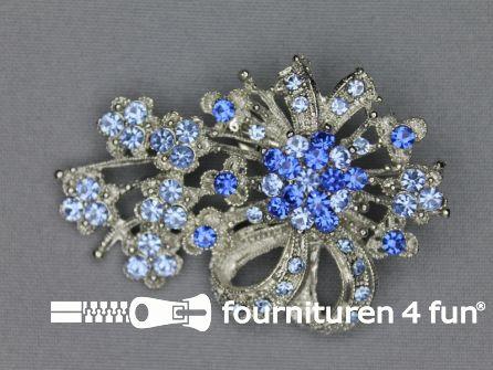 Strass broche 65mm strik licht blauw